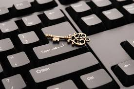 house key and computer keyboard