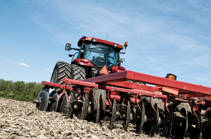 Red tractor tilling the soil. Annual Farmers Stocktake